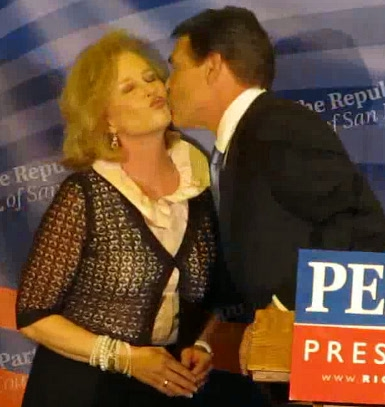 Rick Perry exchanges a kiss with his wife, Anita, at an appearance in San Diego the night of Sept. 7, 2011